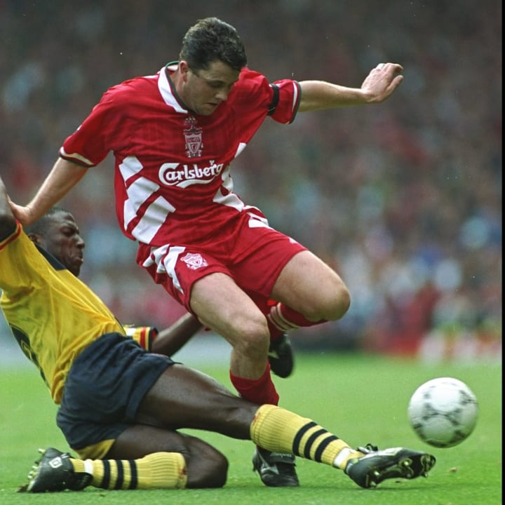 Julian Dicks of Liverpool and Kevin Campbell of Arsenal
