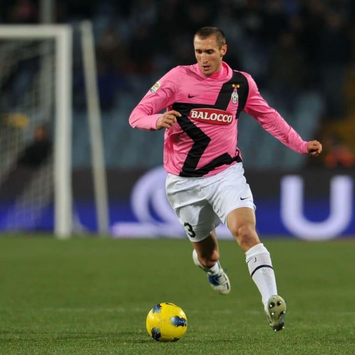 Juventus' Giorgio Chiellini chases the b