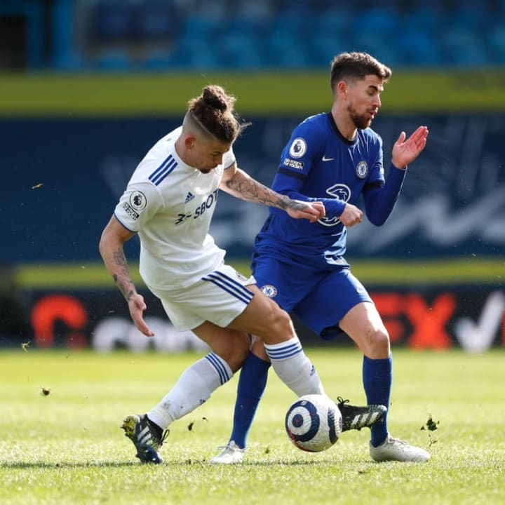 Leeds' Kalvin Phillips crunches into a challenge with Chelsea's Jorginho