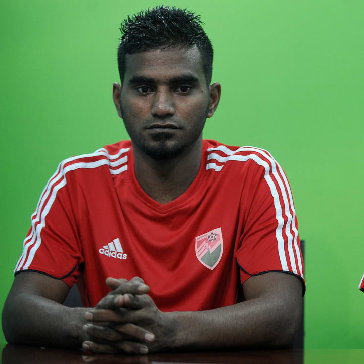 Maldives coach Diego Cruciani (R) and te