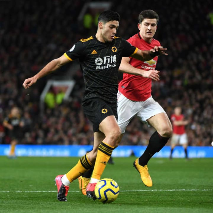Jimenez in action against Manchester United's Harry Maguire