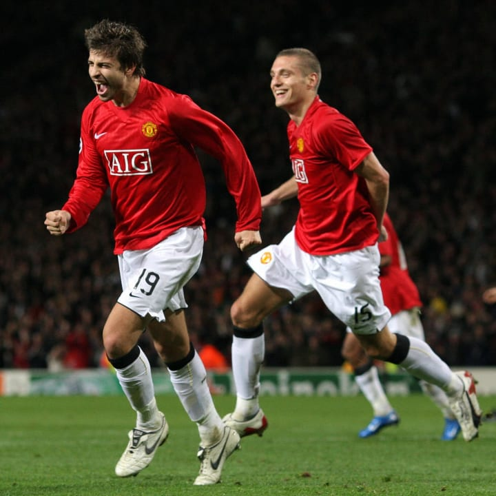 Manchester United's Gerard Pique (L) cel