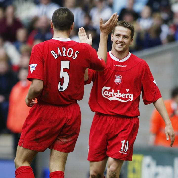 Michael Owen of Liverpool celebrates another goal with team-mate Milan Baros