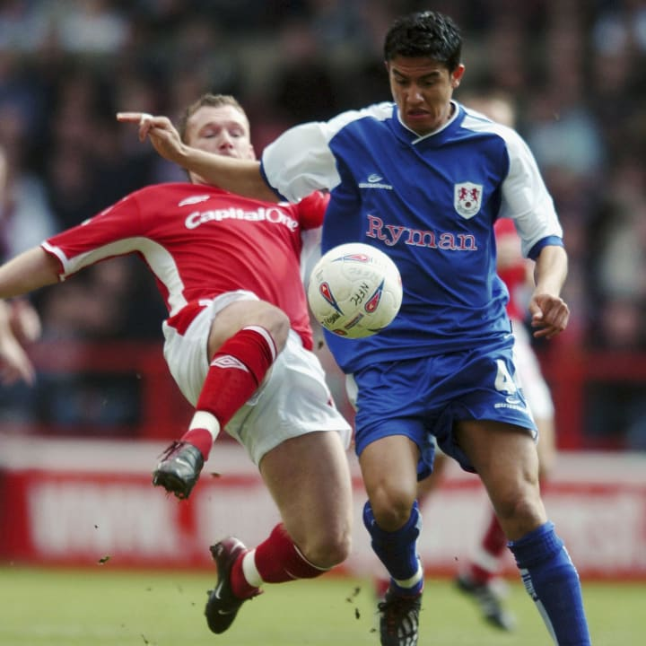 Tim Cahill, Paul Evans