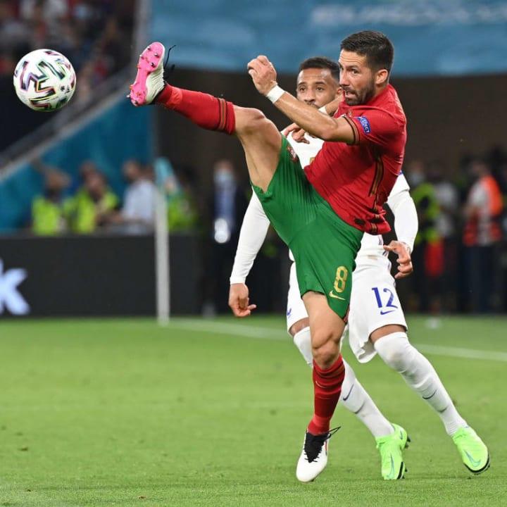 Joao Moutinho looks to control the ball