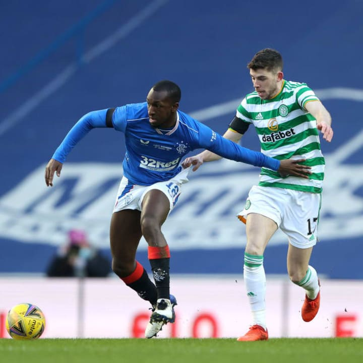 Ryan Christie battles in midfield