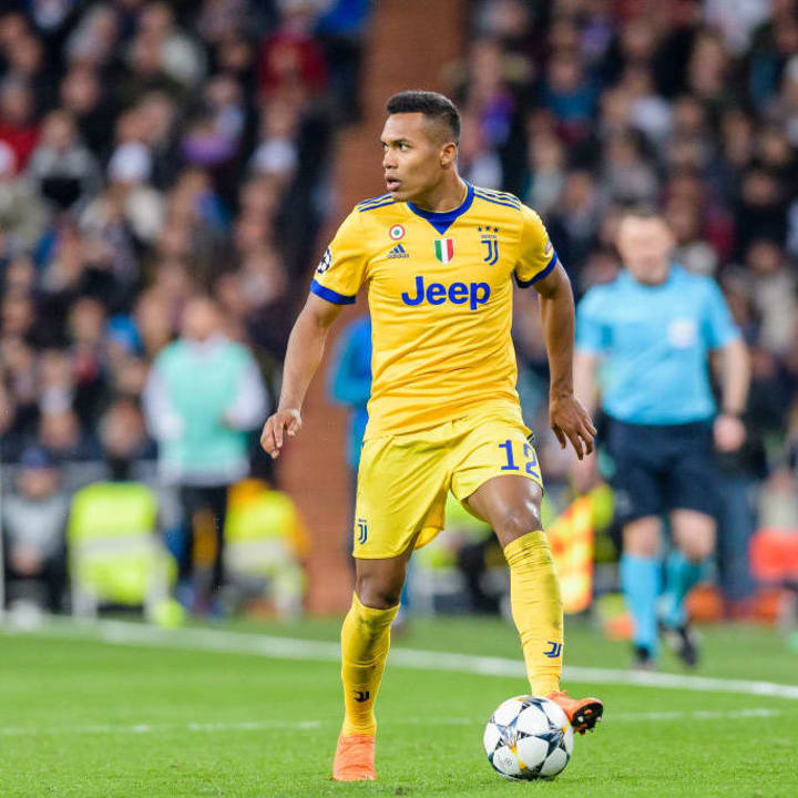Alex Sandro wears Juventus' most recent yellow kit