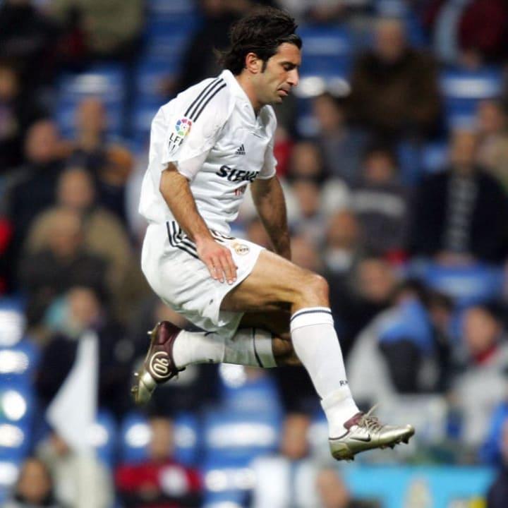 Real Madrid's Portuguese Luis Figo (abov