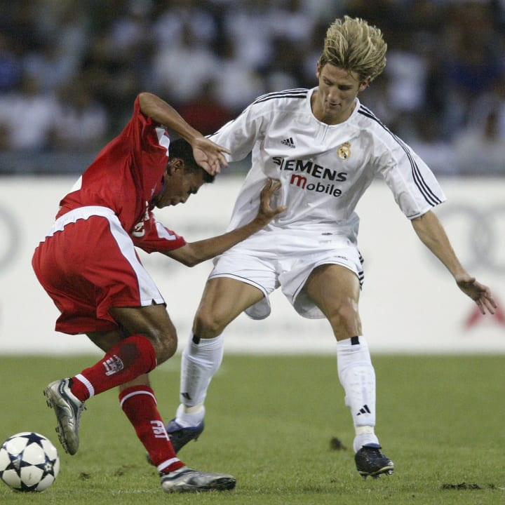 Ruben Gonzalez Rocha of Real Madrid tackles Somjed Suttabut of Thailand