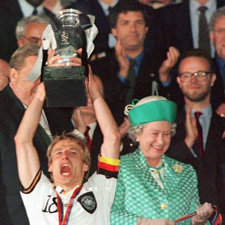Jürgen Klinsmann holds the trophy aloft