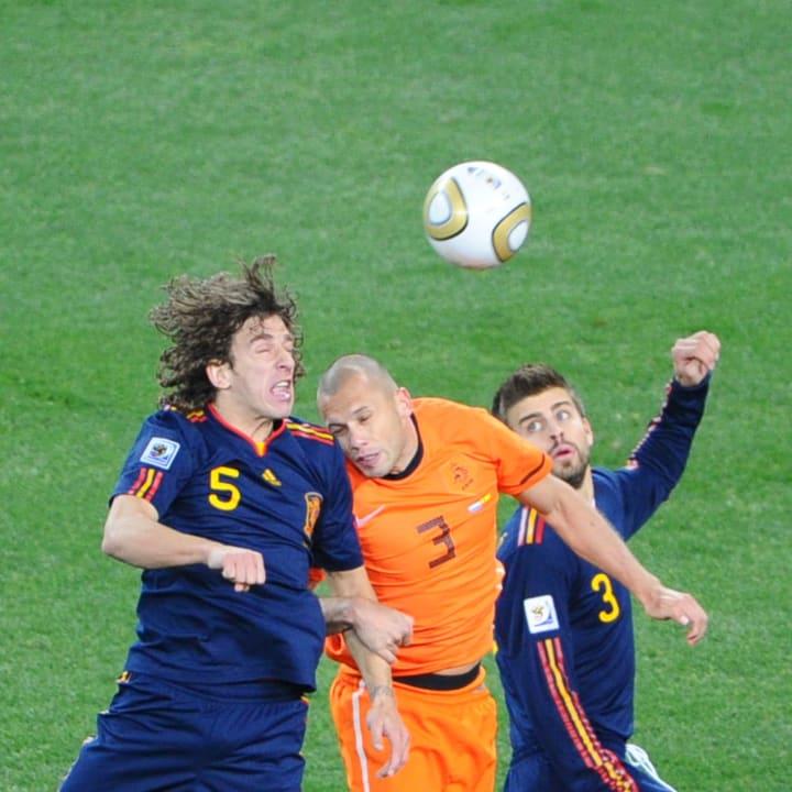 Spain's defender Carles Puyol (L) heads
