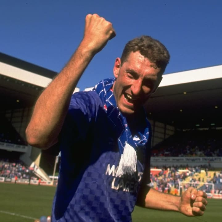 Terry Butcher of Rangers salutes victoriously after the Scottish Premier League match