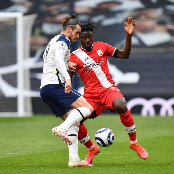 Mohammed Salisu blocks off Gareth Bale's route to goal