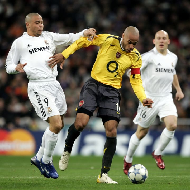 Henry shrugs off Ronaldo's challenge
