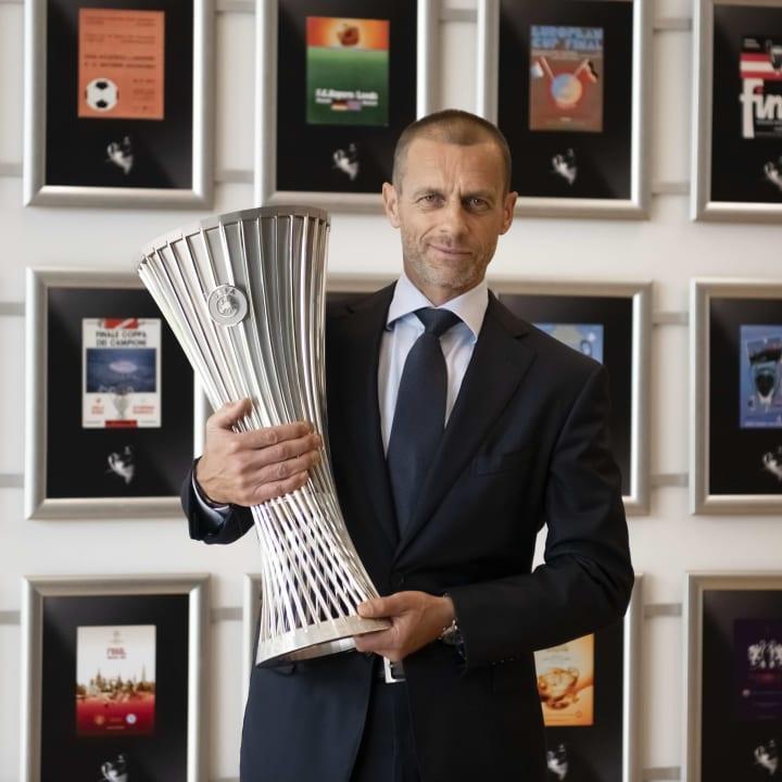 Aleksander Ceferin holds the trophy