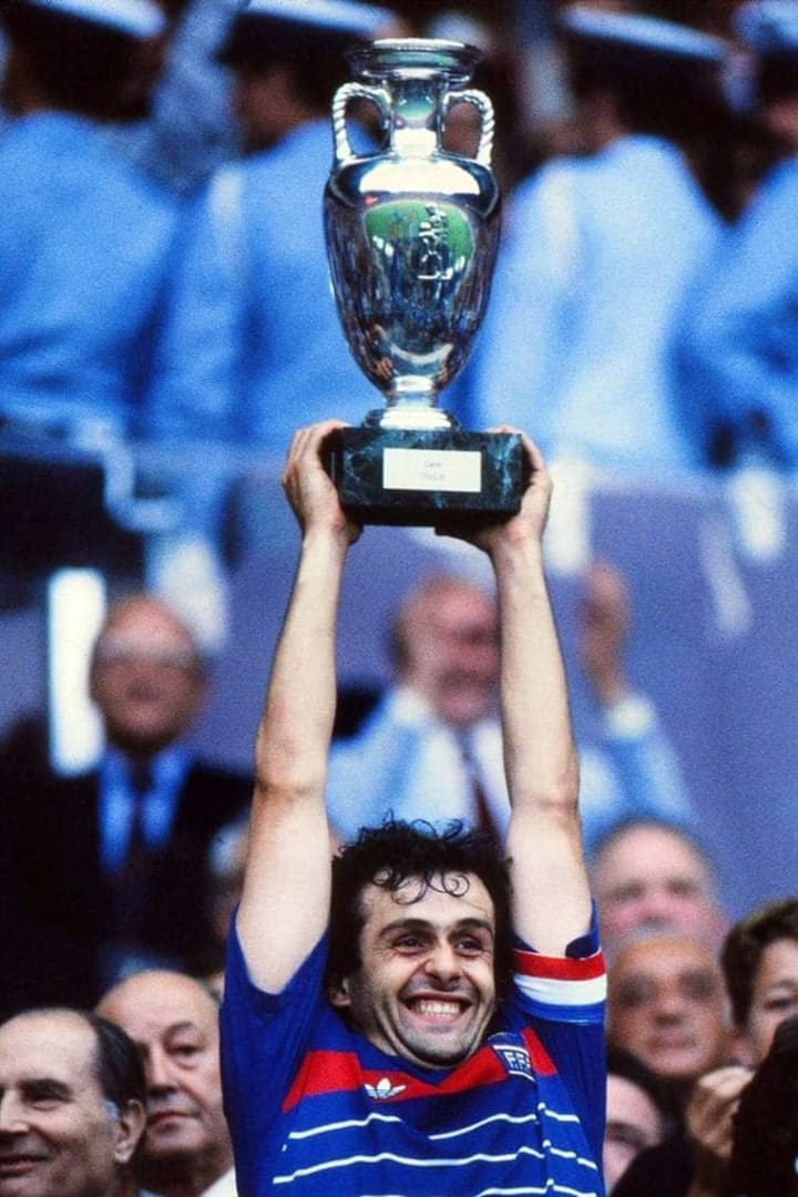 Michel Platini holds the trophy aloft at Euro 84