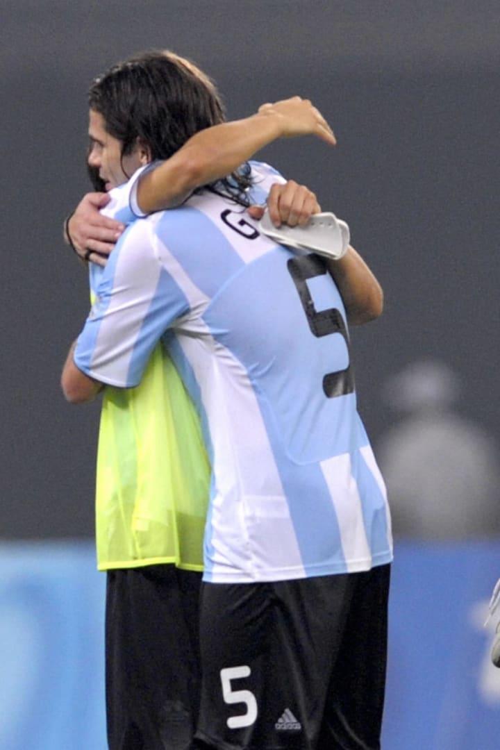 Argentina's Ever Banega (R) hugs teammat