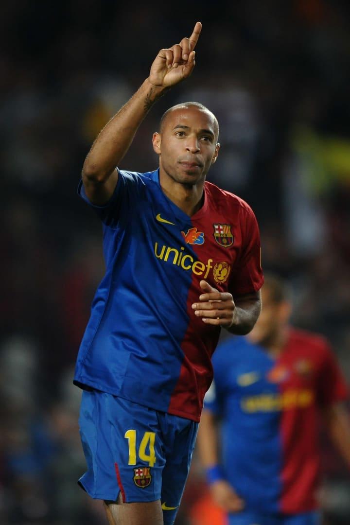 Henry celebrates his goal against Valencia