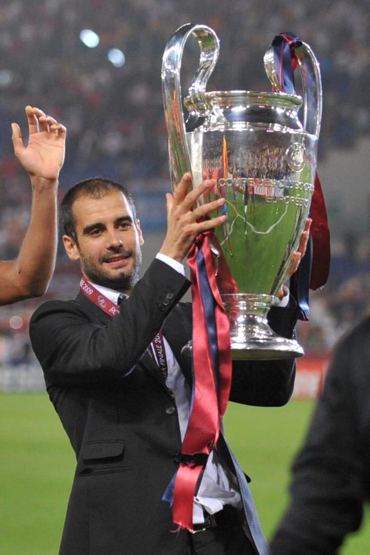 Barcelona´s coach Josep Guardiola holds