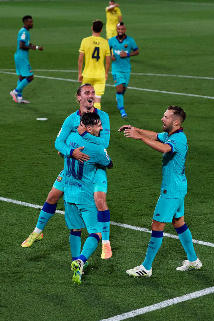 Griezmann celebrates with Lionel Messi during Barcelona's 4-1 win over Villarreal