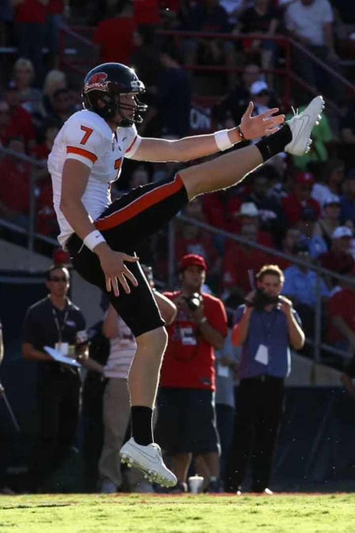TUCSON, AZ - OCTOBER 09: Punter Johnny Hekker #7 of the Oregon State Beavers kicks the football during the college football game against the Arizona W