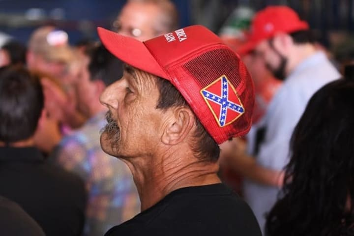 Trump follower listens closely to his leader's words at a recent rally