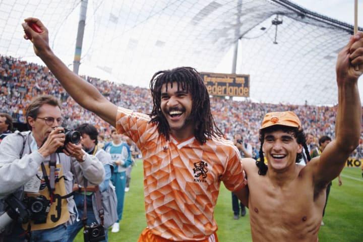 Ruud Gullit celebrates with Gerald Vanenburg