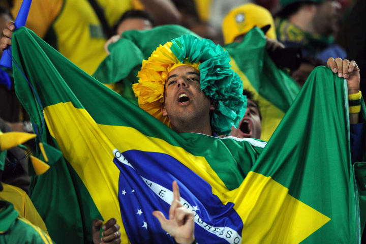 A Brazil supporter celebrates after his
