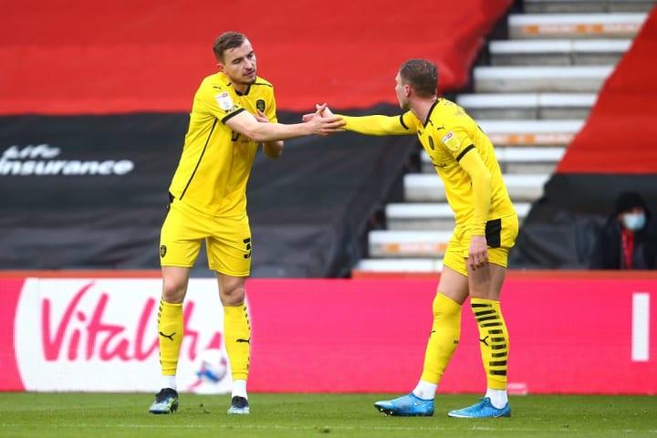 Cauley Woodrow and Michal Helik celebrate Barnsley's huge win at Bournemouth