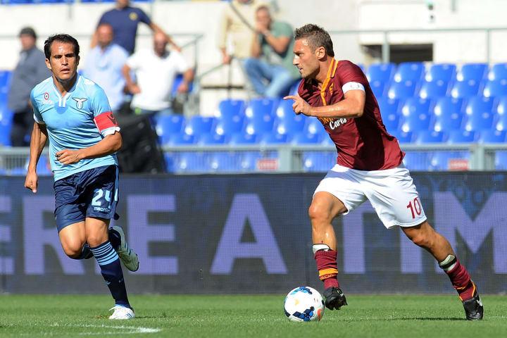 Ledesma e Totti, per tanto tempo capitani di Roma e Lazio