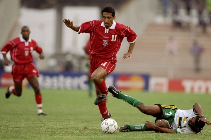 Adel Sellimi of Tunisia is Challenged by Papi Khomane of South Africa...