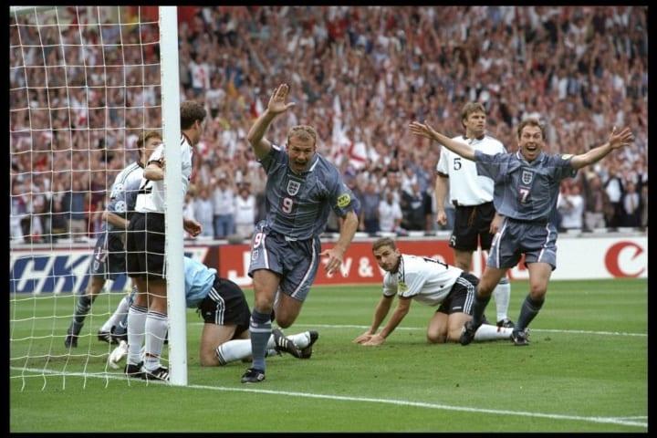 Alan Shearer (number 9) scores for England