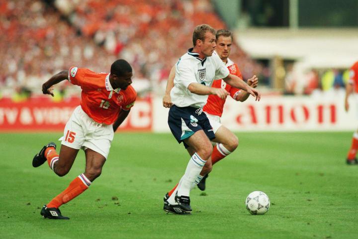 Alan Shearer of England and Winston Bogarde of Holland