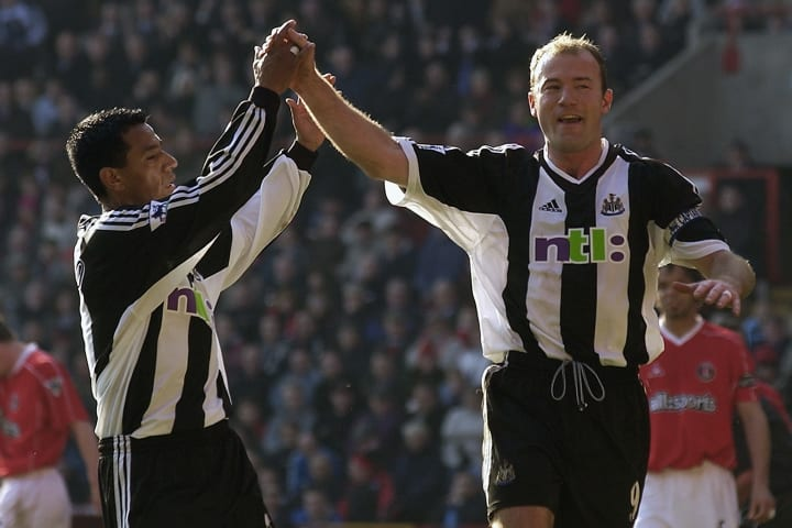Alan Shearer of Newcastle United celebrates scoring the opening goal from the penalty spot with team-mate Nolberto Solano