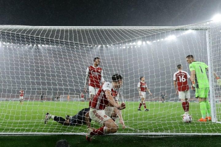 Kieran Tierney falls into the net as Arsenal concede their second against Villa