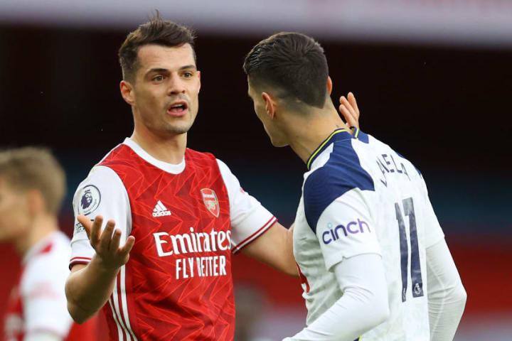 Arsenal's Granit Xhaka squares up to Tottenham's Erik Lamela