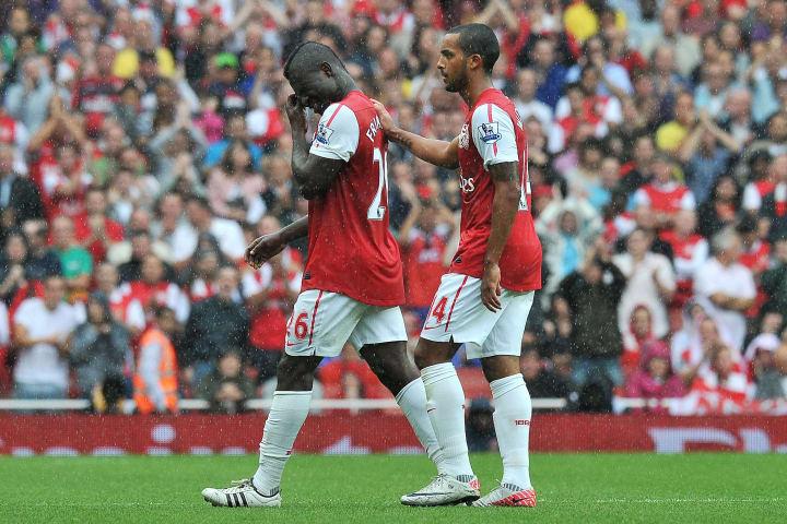 Theo Walcott comforting Emmanuel Frimpong
