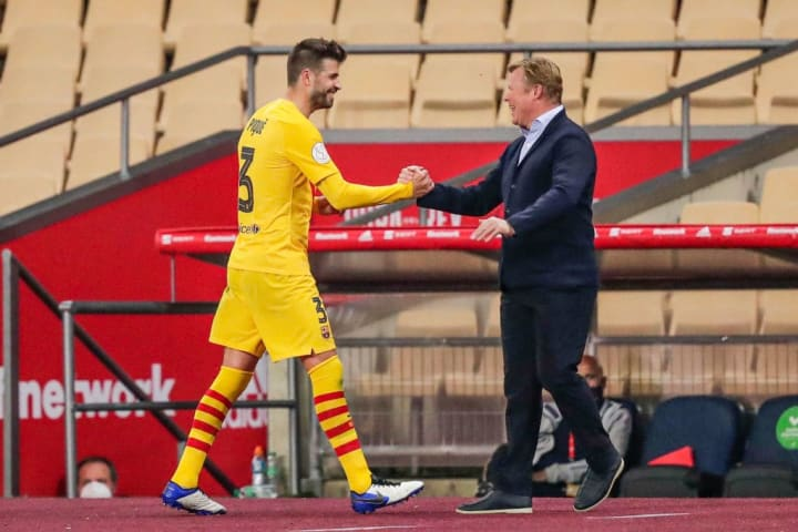 Gerard Pique and Barcelona manager Ronald Koeman