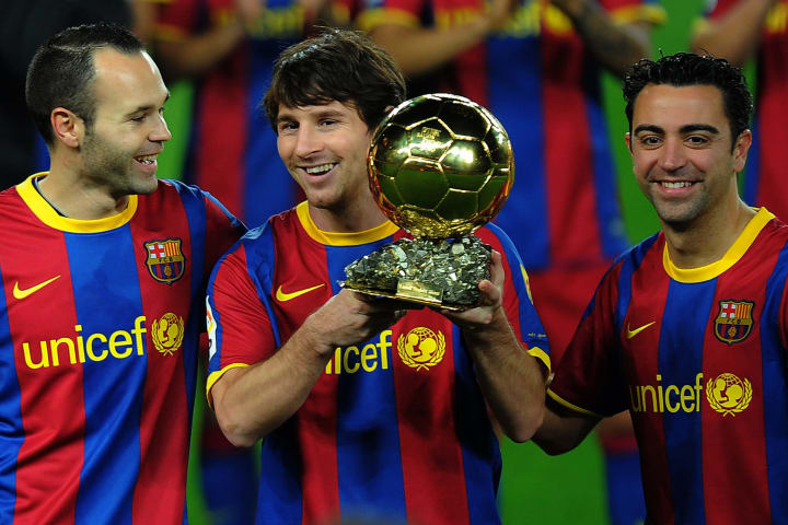 Andres Iniesta (left), Lionel Messi (centre) and Xavi (right)