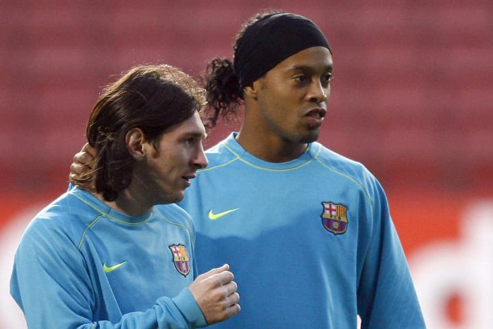 Ronaldinho with Lionel Messi during his time at Barcelona