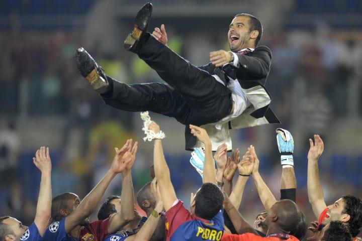 Barcelona´s coach Josep Guardiola (top)