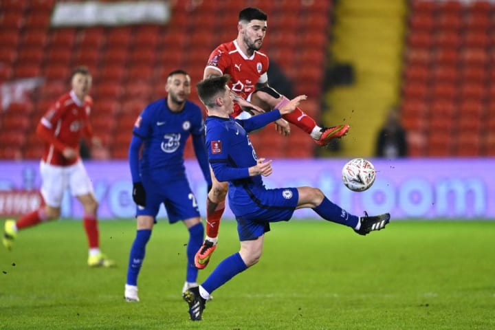Billy Gilmour lunges into a challenge