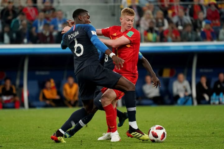 Pogba and De Bruyne lock horns