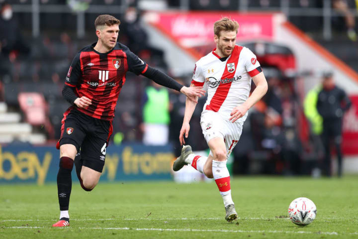 Stuart Armstrong charges away from Chris Mepham