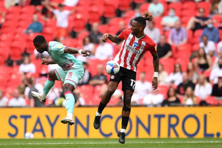 Ivan Toney challenges for the ball