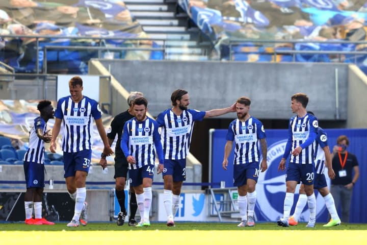 Brighton players celebrating against Arsenal