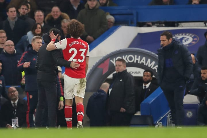 Mikel Arteta embraces David Luiz after his red card at Chelsea