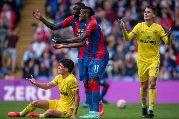 Cheikhou Kouyate and Wilfried Zaha against Brentford