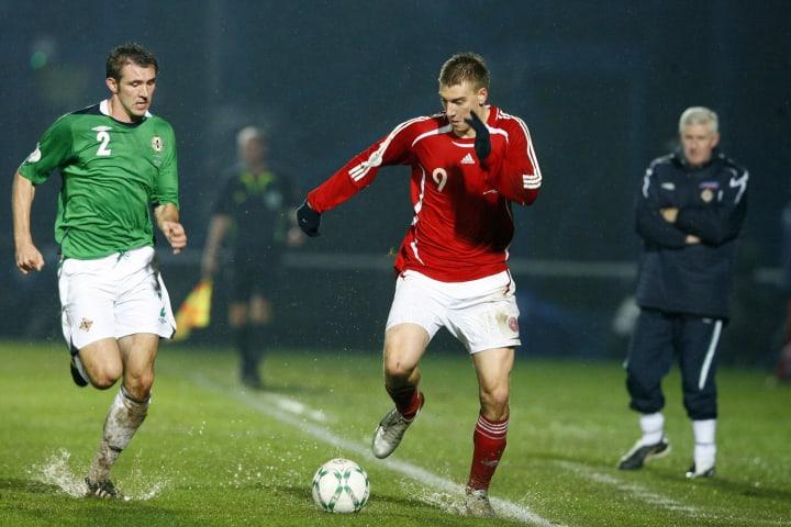 Danish footballer Nicklas Bendtner (R) v