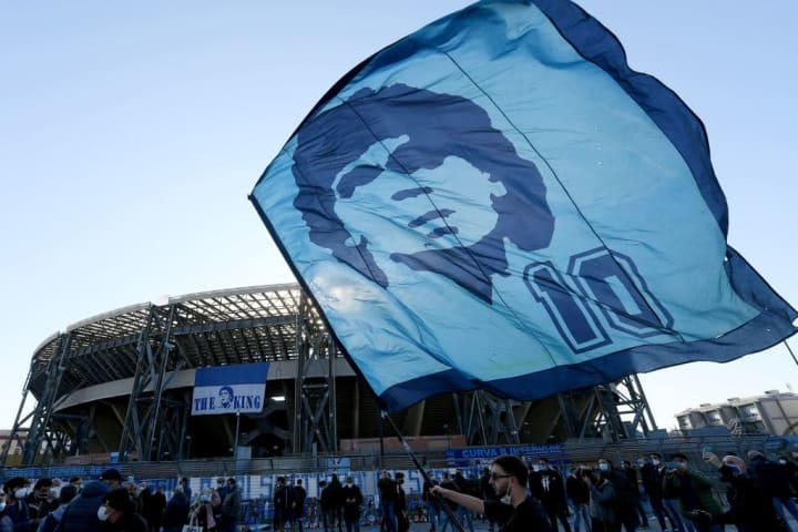 Fans mourn Maradona's passing outside the San Paolo stadium in Naples